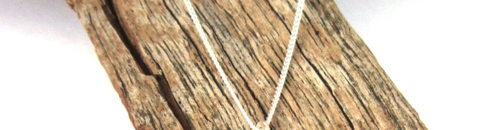 Lost at Sea Hidden picture dual sided necklace